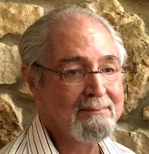 Kenneth E. Heller