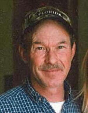 Mark E. Washburn