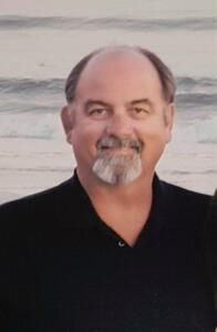 Mark A. Luttman