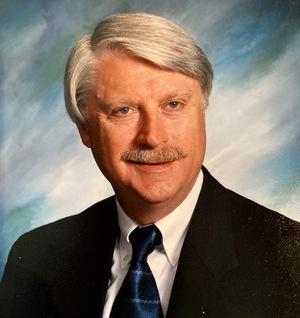 Dr. John H. Persing