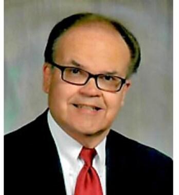 WILLIAM E.  TOMEY, JR.
