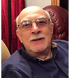 ROBERT J. ADAMEK